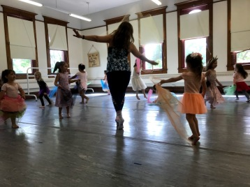 "Kimberly Payne leading freeze dance in ""Happy Unicorn Camp"" 2019, Photo Credit Lynn Jones"