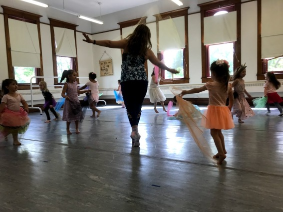 "Kimberly Payne leading freeze dance in ""Happy Unicorn Camp"" 2019, Photo Credit Lynn Jones"